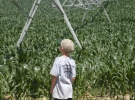 Caseys son helping on a pivot call